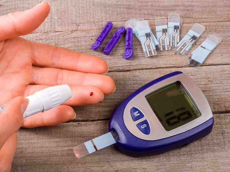 patient testing blood glucose levels