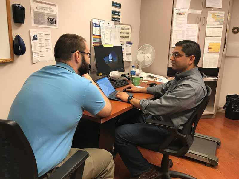 Asim Jaffer, M.D., (right) precepts residents like third-year resident Nathan Gallagher, M.D., at the UnityPoint Clinic-Family Medicine in Peoria, Ill.
