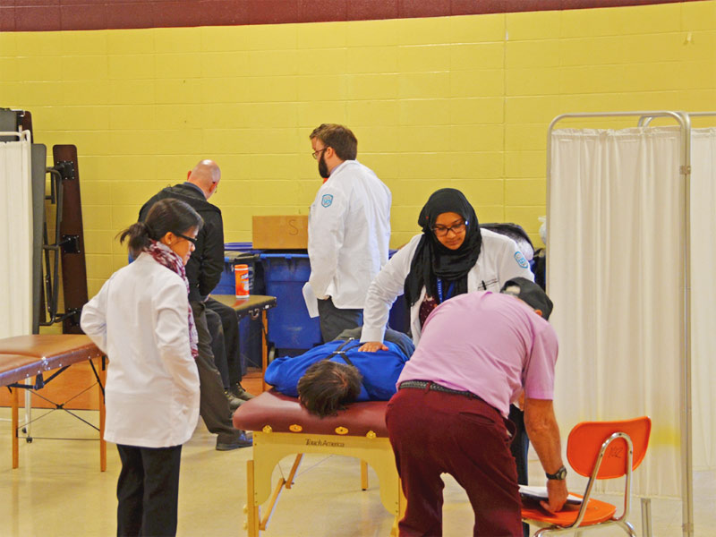 Osteopathic medical students from A.T. Still University's Kirksville College of Osteopathic Medicine treat an Amish patient during a free health fair put on by Still Caring Health Connection-Volunteers in Medicine.