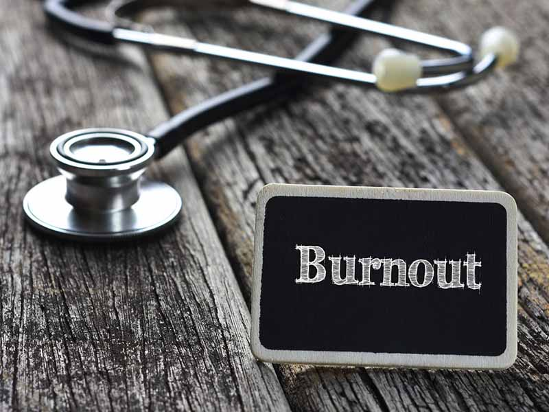 burnout sign and stethoscope