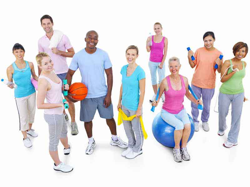 group of people with various pieces of exercise equipment