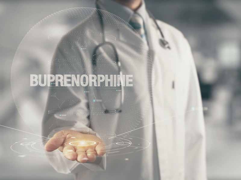 image of physician holding virtual disk with buprenorphine superimposed on it