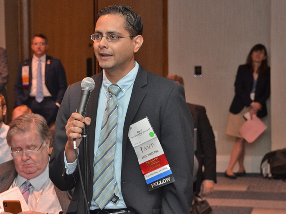 Ravi Grivois-Shah, M.D., testifies during a reference committee hearing