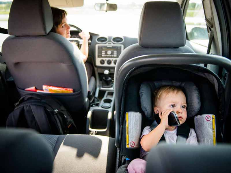 infant sitting in car seat in vehicle