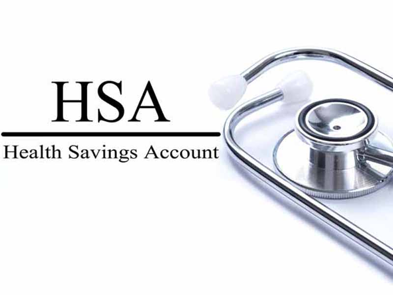 Page with HSA (Health Savings Account) on the table with stethoscope, medical concept