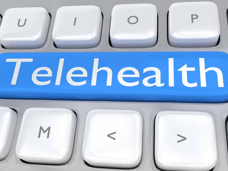 "3D illustration of computer keyboard with the script ""Telehealth"" on pale blue button. Remote service concept."