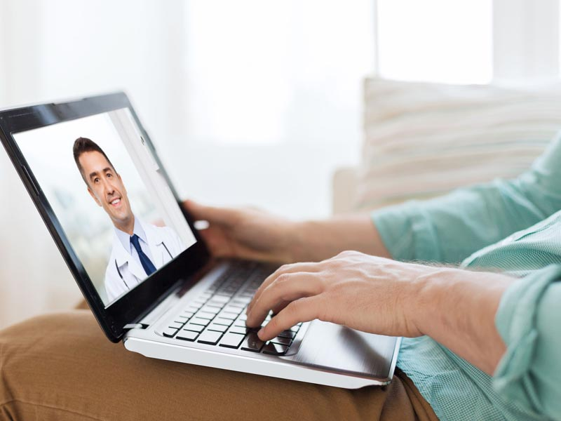 patient having video call with doctor on laptop