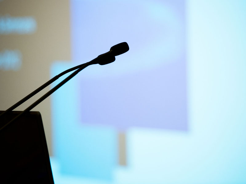 lectern and microphones in conference room