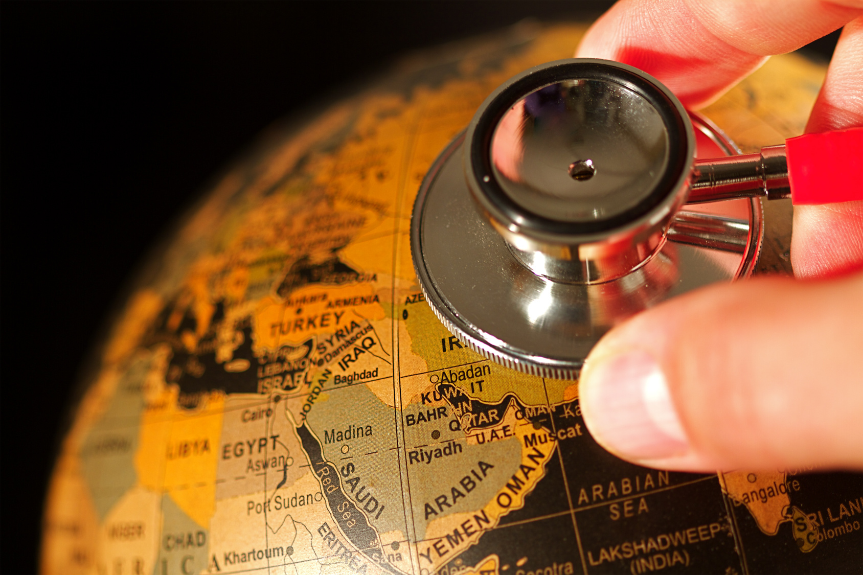 Stethoscope on a globe.