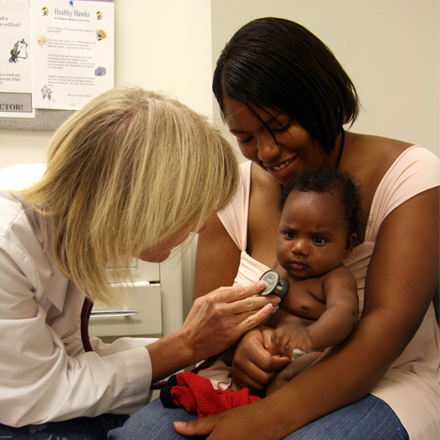 A practicing physician examines a child patient.