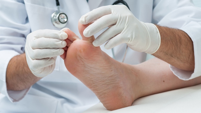 Physician checking patient's feet