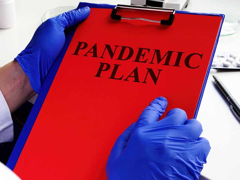 physician holding pandemic plan