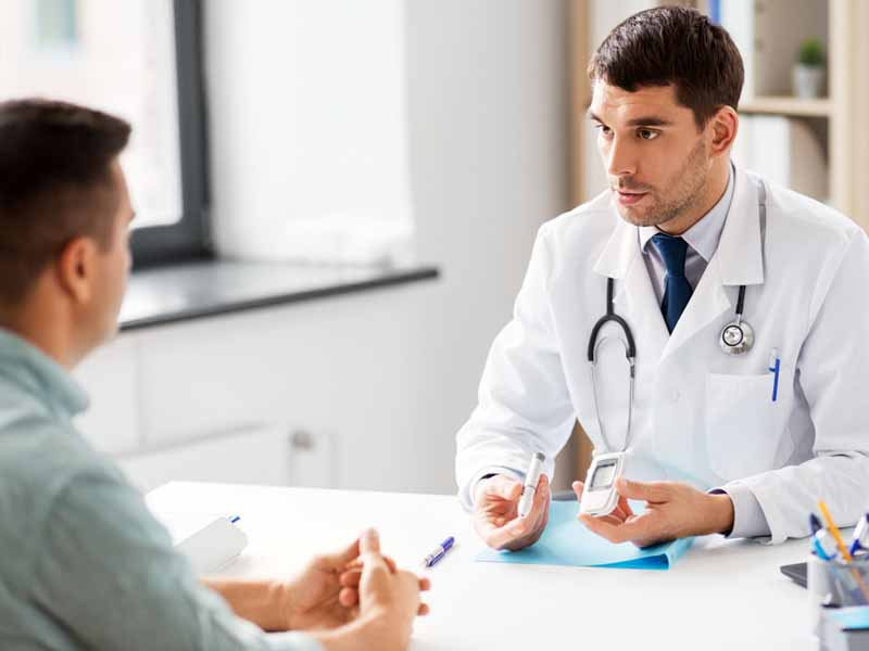 physician discussing diabetes care with patient