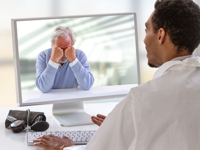 telehealth session between physician and older patient