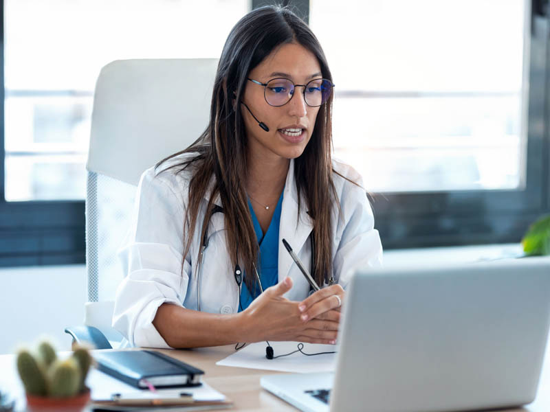 physician talking to patient on computer