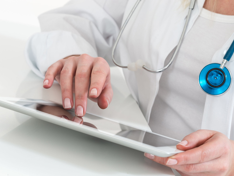 physician working with tablet computer