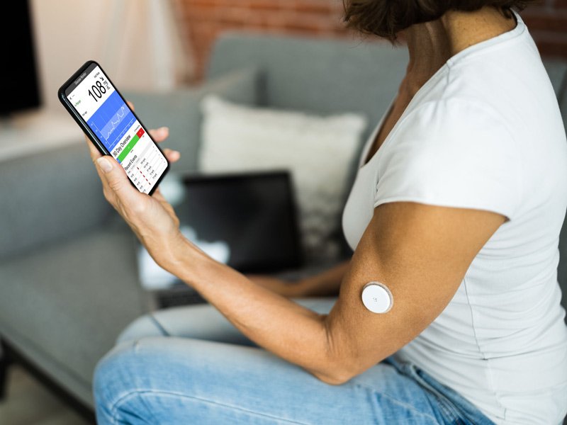 patient using continuous glucose monitor
