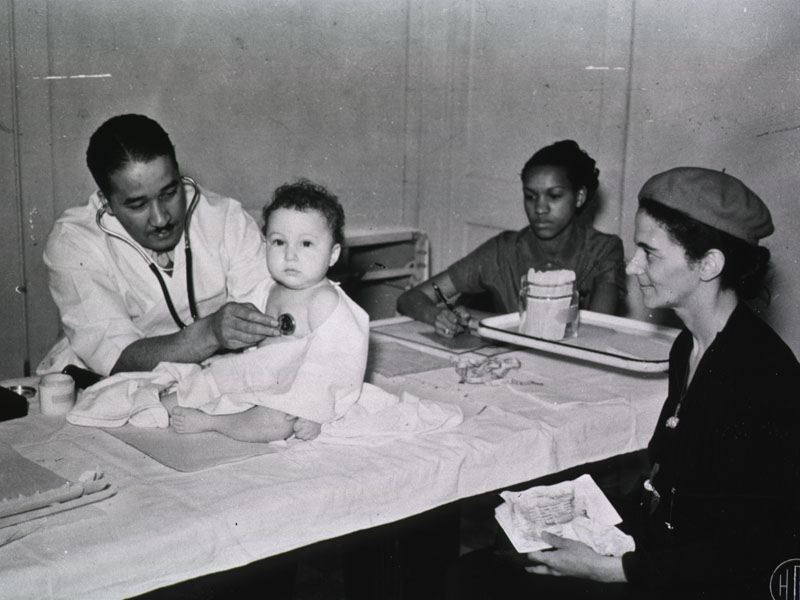 physician examining infant